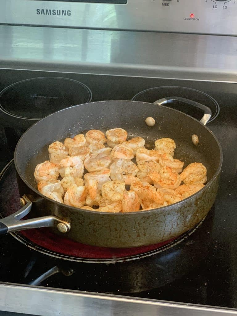 Cook shrimp in a pan to brown them