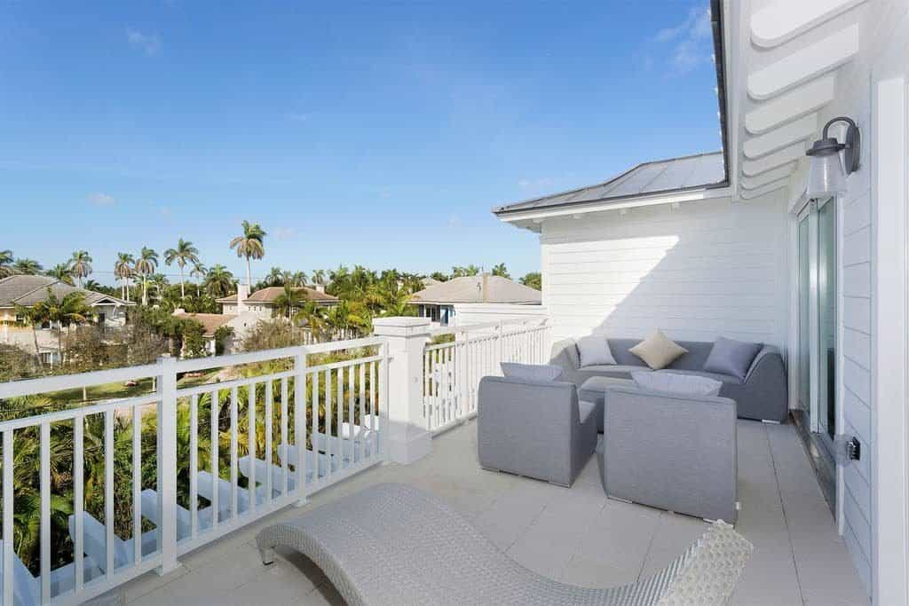 Beach House Outdoor Living Space Ideas - Gray outdoor couch and lounges on balcony