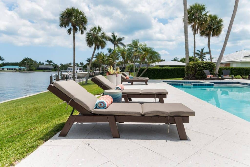 Beach House Outdoor Living Space Ideas - Wood lounge chairs by pool