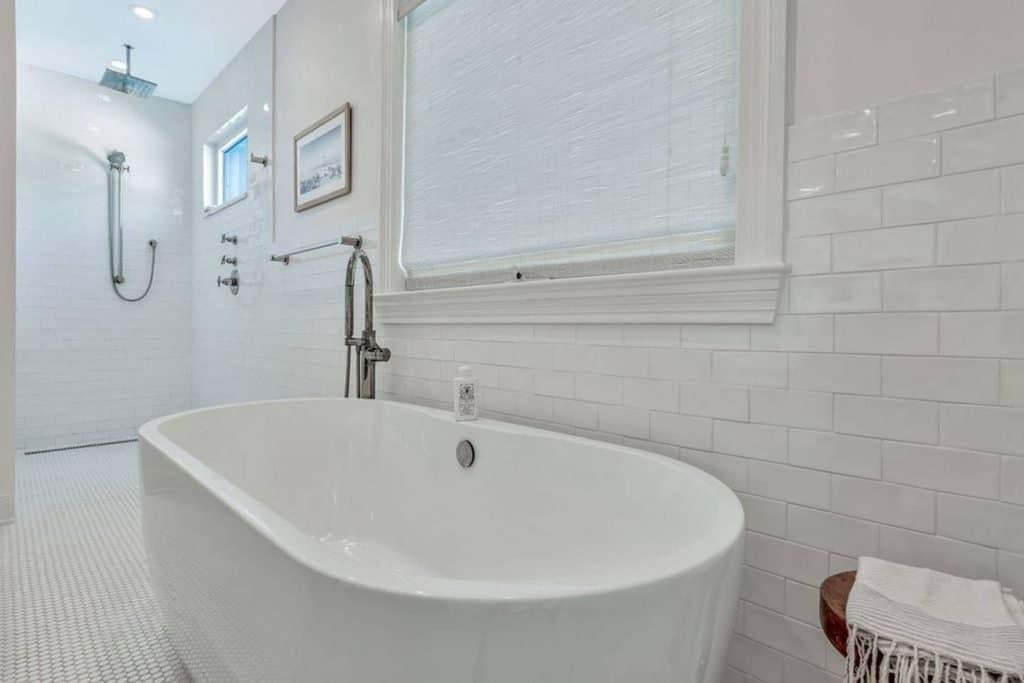 Bohemian Elegant Luxury Paradise AirBnb Beach House Decor - master bathroom with white freestanding tub