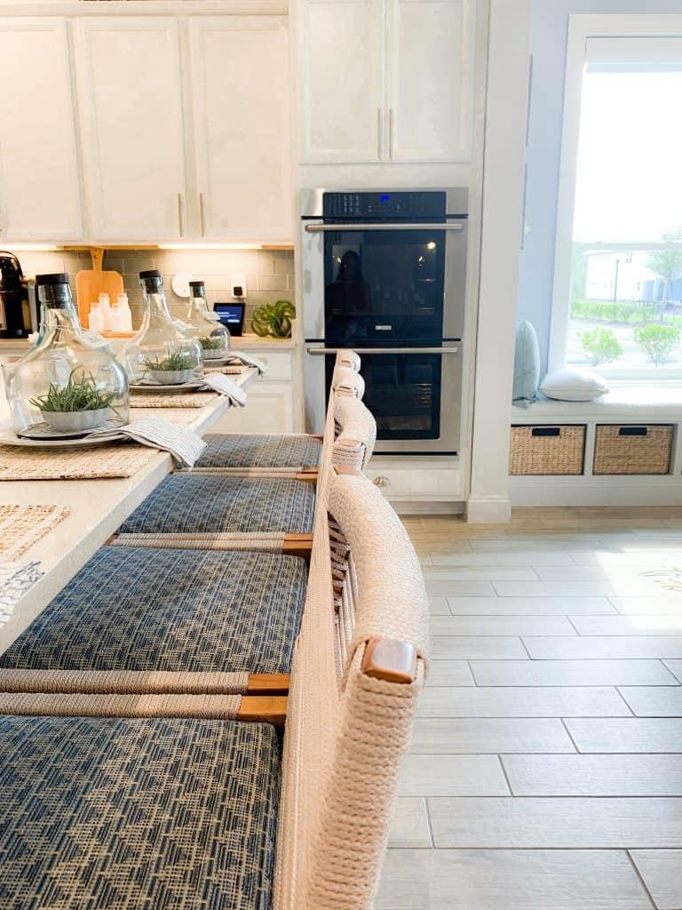 Beach Walk House Tour - Coastal Chic Design and Decor Ideas - Bar stools at island in white kitchen