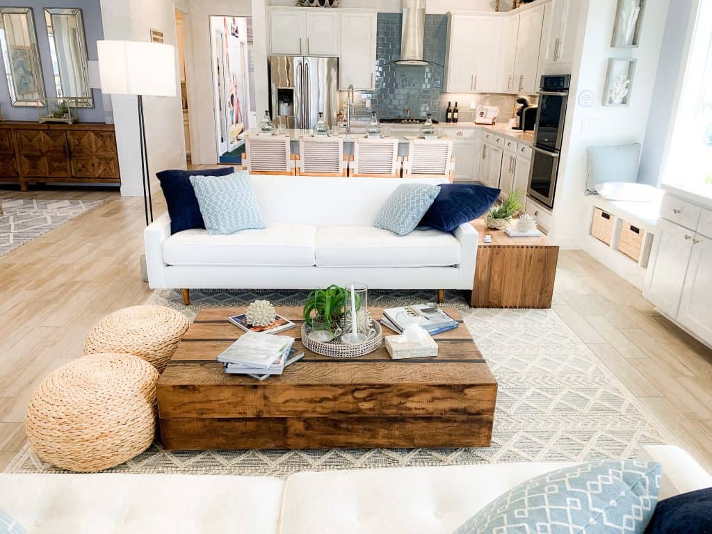 Beach Walk House Tour - Coastal Chic Design and Decor Ideas - White couches in living room with wood coffee table