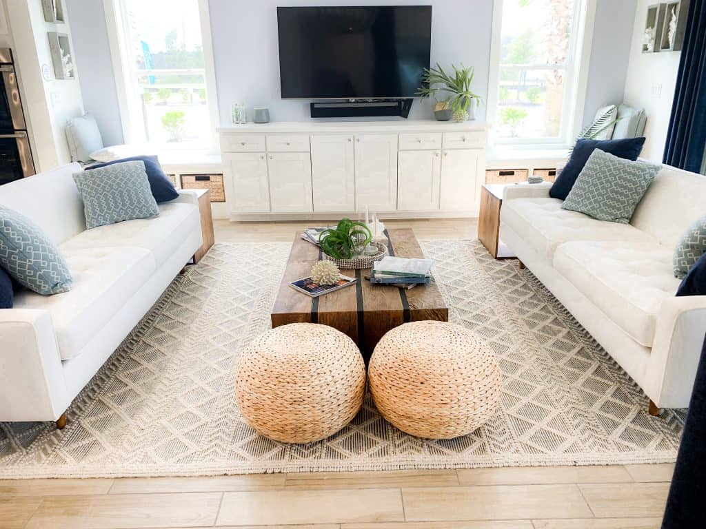 Beach Walk House Tour - Coastal Chic Design and Decor Ideas - White neutral living room with navy blue accents