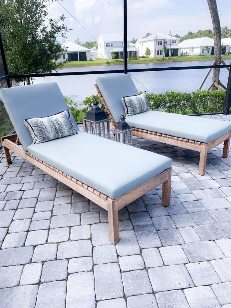 Beach Walk House Tour - Coastal Chic Design and Decor Ideas - Teak outdoor lounge chairs with light blue cushions