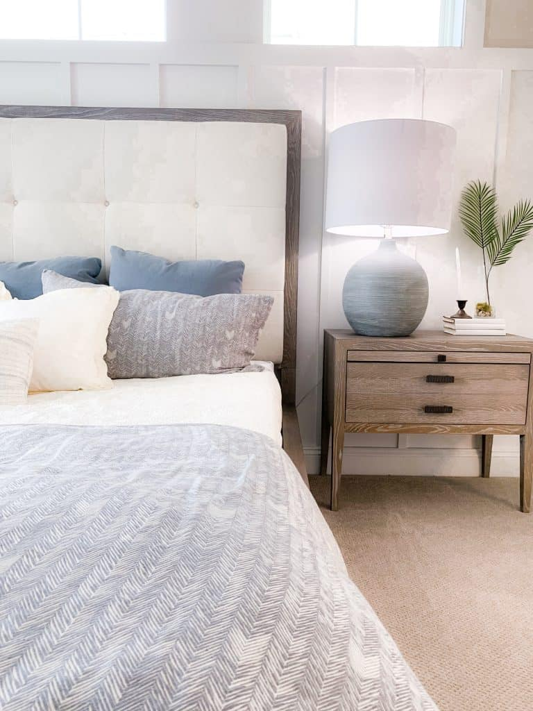 Beach Walk House Tour - Coastal Chic Design and Decor Ideas - Bedroom with white ship lap and neutral blues