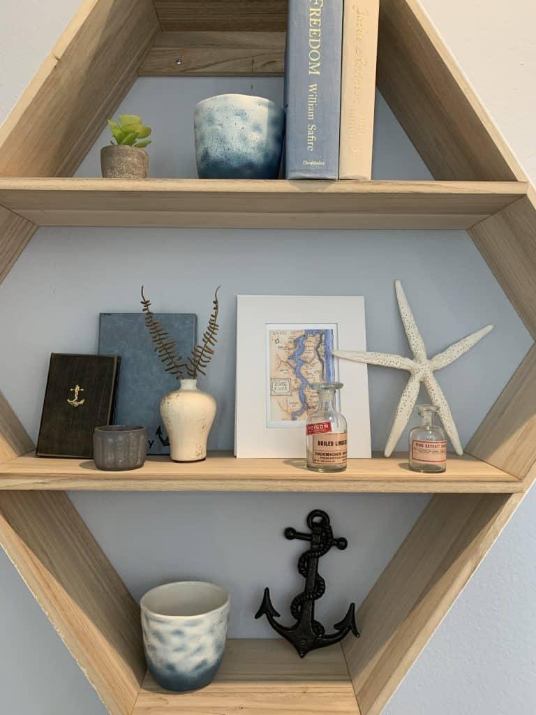 Beach Walk House Tour - Coastal Chic Design and Decor Ideas - mounted wood wall shelf
