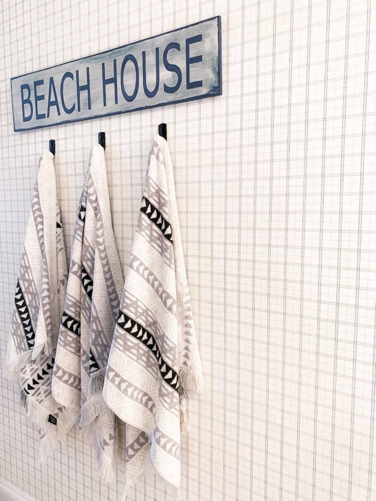 Beach Walk House Tour - Coastal Chic Design and Decor Ideas - beach house sign towel rack
