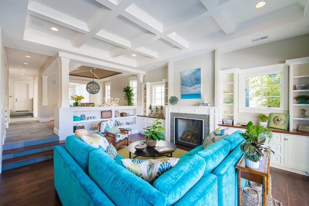 Blue Coastal Dream | Beach House Decor Ideas | Living room with blue couch and ceiling with beams