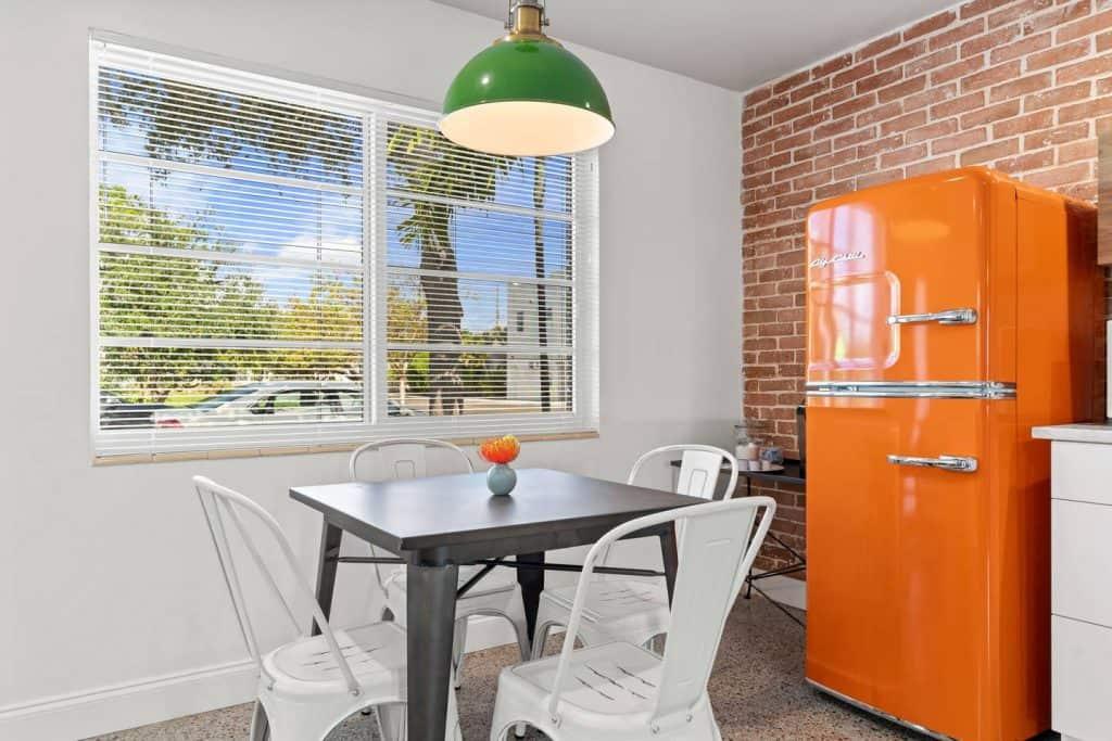 Orange Blossom Villa - Lake Worth Beach Airbnb Vacation Rental - Orange Retro Refrigerator