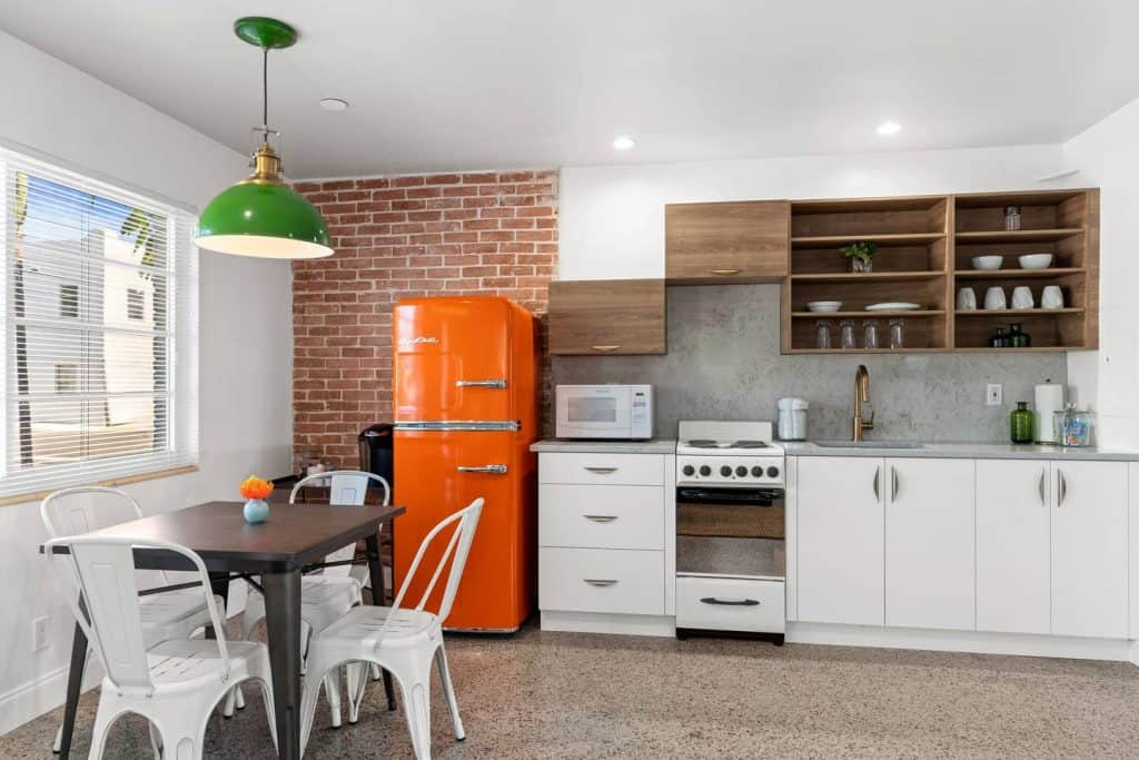 Orange Blossom Villa - Lake Worth Beach Airbnb Vacation Rental - Kitchen with Orange Fridge
