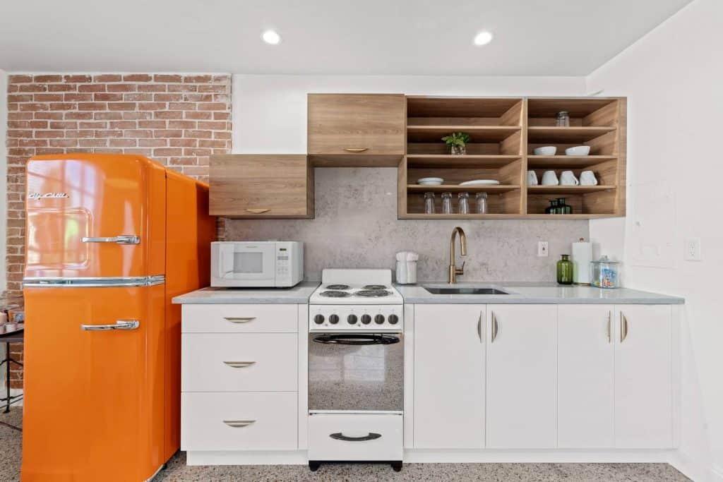 Orange Blossom Villa - Lake Worth Beach Airbnb Vacation Rental - Kitchen with orange retro refrigerator