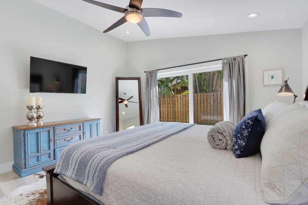 The Bent Palm Jupiter FL AirBnb Guest Bedroom with blue dresser