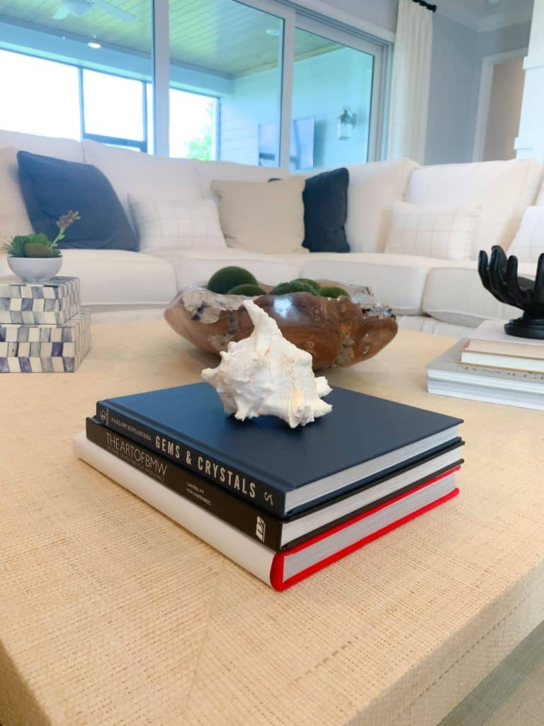 Coffee table styling with books and beach shells
