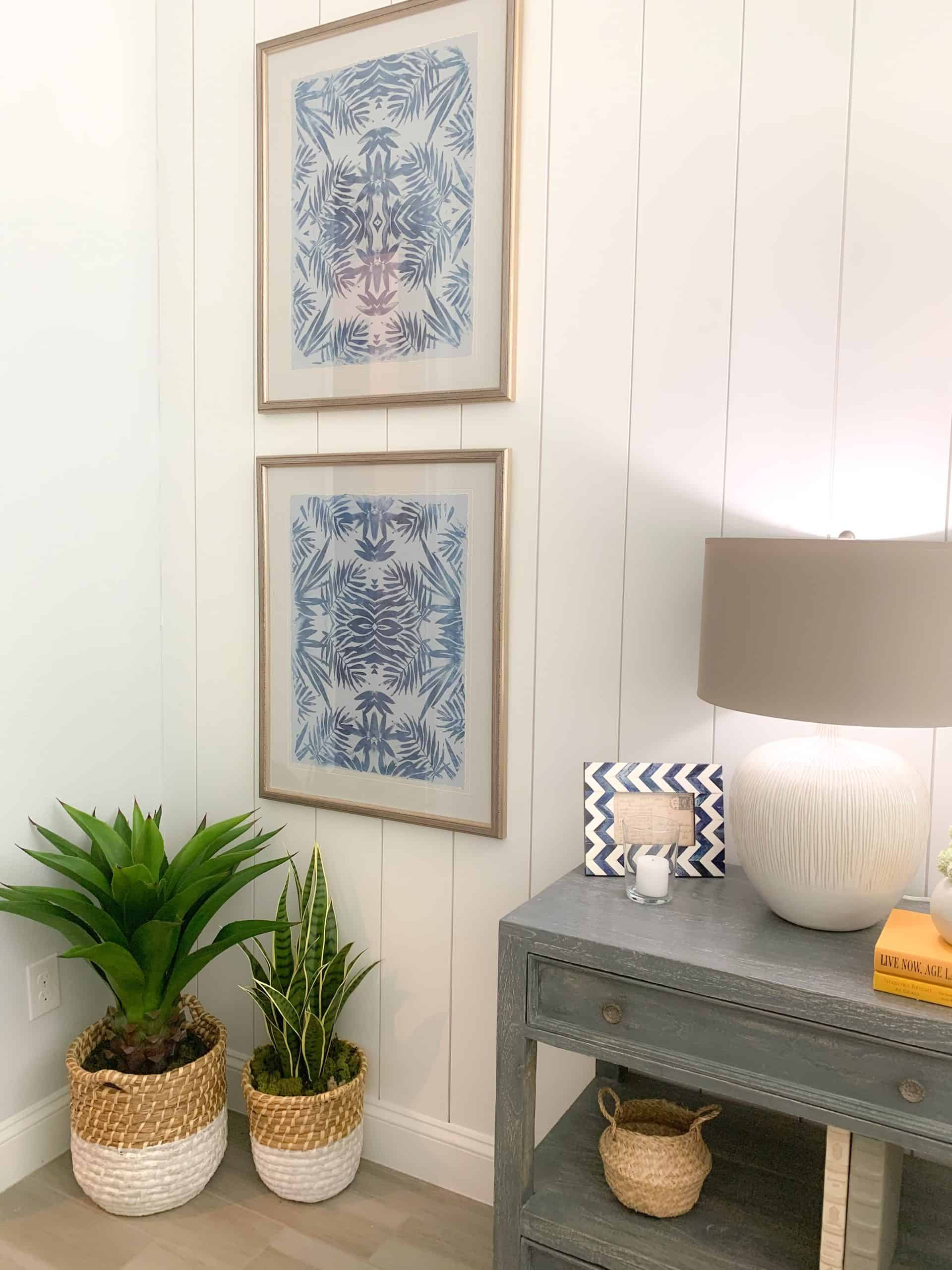 Guest bedroom styling with gray end table and greenery plant accents