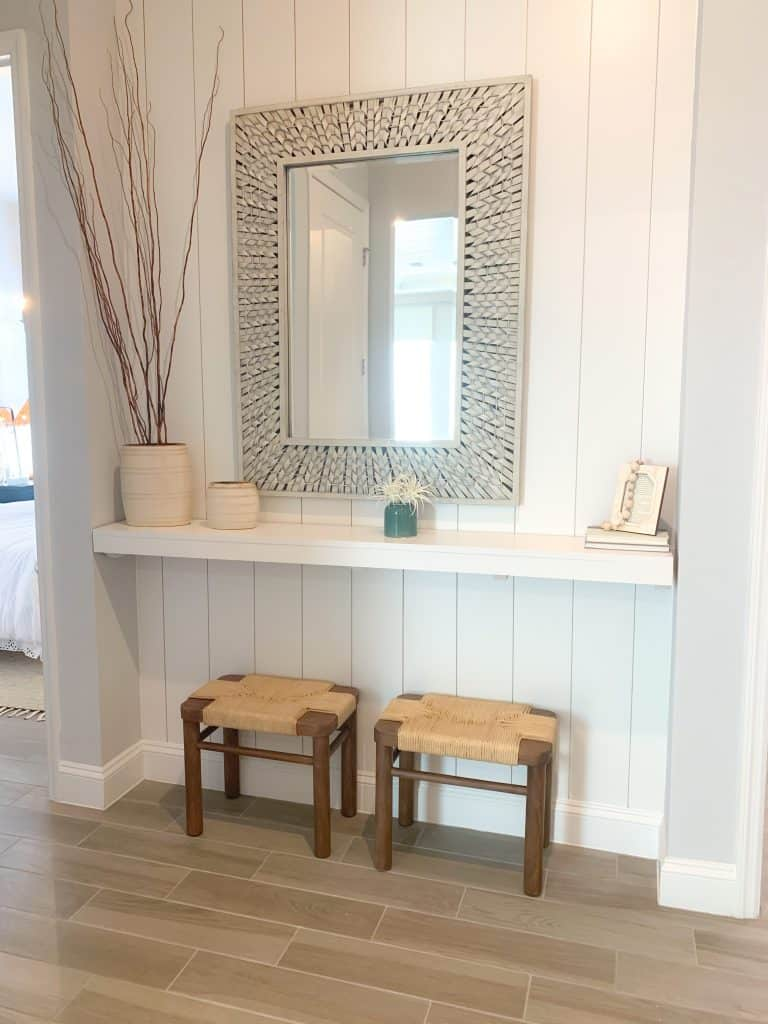 Hallway shelf with mirror and coastal decor accents