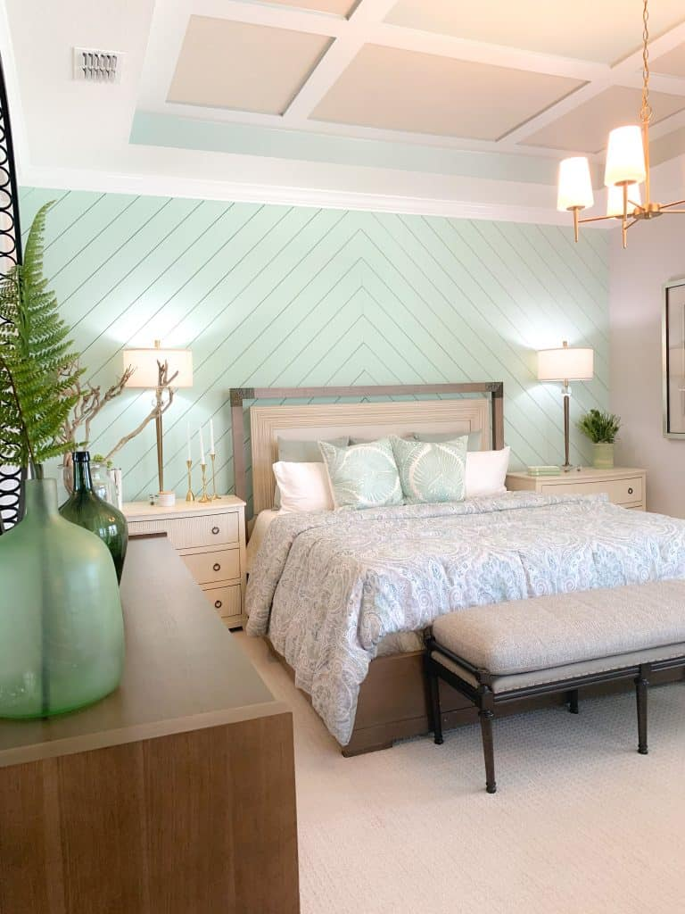 Seafoam Green Shiplap Accent Wall In Master Bedroom