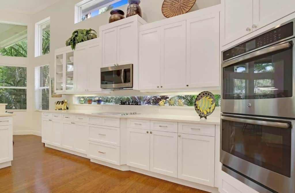 White Cabinets in Kitchen With Medium Wood Floors