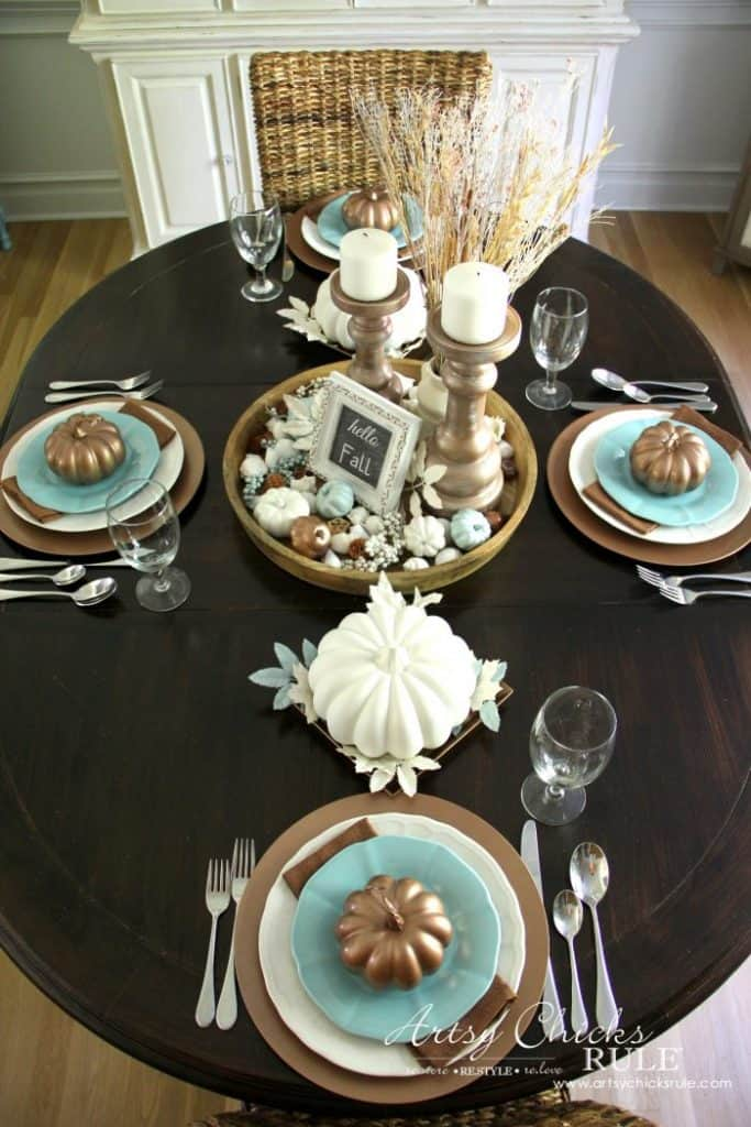 Dark wood table with coastal blue accents on a casual coastal fall table