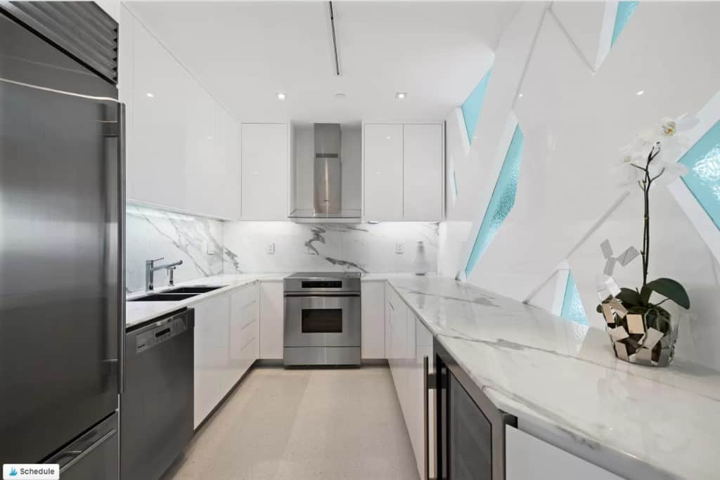 White kitchen with funky glass cut outs Miami style