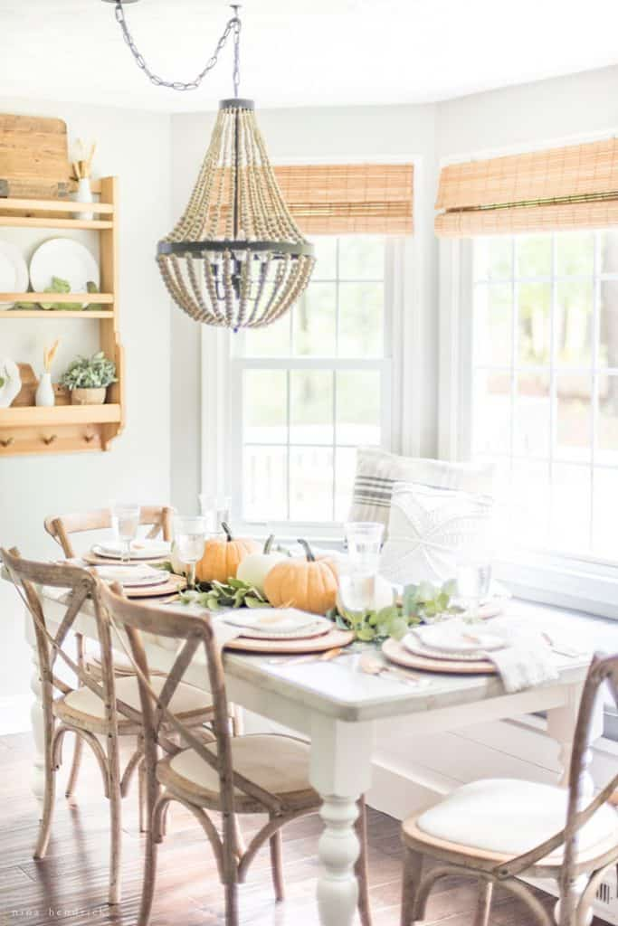 MUTED FALL TABLESCAPE - Neutral place settings, greenery across the table, pumpkin decor centerpiece