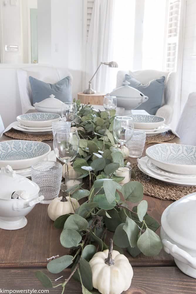 Simple Fall Tablescape With Greenery, White and Blue plates, and Burlap placemats