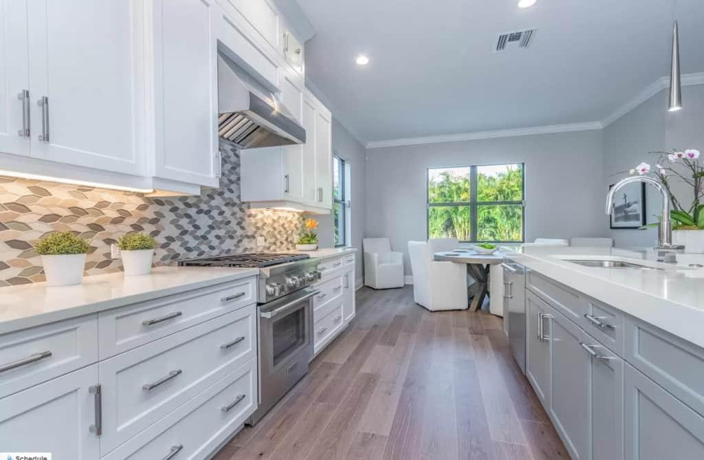 Model home white kitchen with fun backsplash