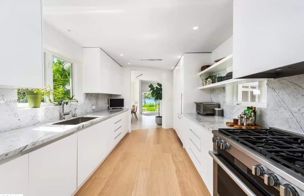 White Galley Kitchen With Marble Gray Countertops