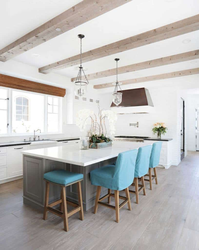 Bayshore Beach House Kitchen - White Island With Blue Bar Stools - Light Wood Beams