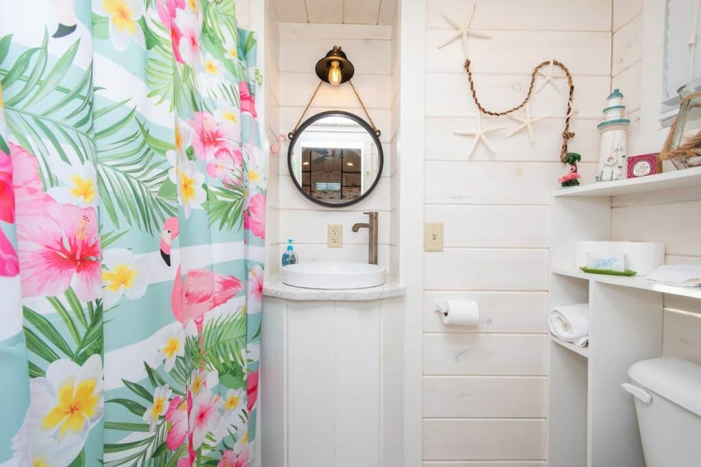 Flamingo Bathroom with beach wood shiplap walls and built in shelving