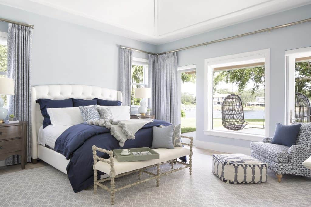 Navy Accent Pillows and Bedding in Calm Coastal Master Bedroom - Coastal Calm Home Design With Amazing Relaxed Beach Décor Ideas