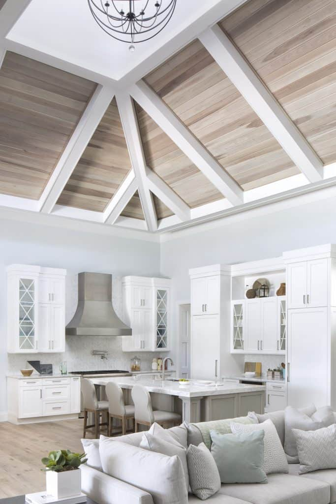 Coastal Calm Open White Kitchen Vaulted Wood Ceilings