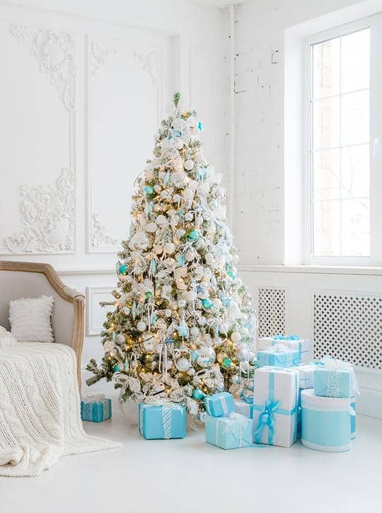 Baby blue and white Christmas tree photo backdrop for holiday family photo shoot