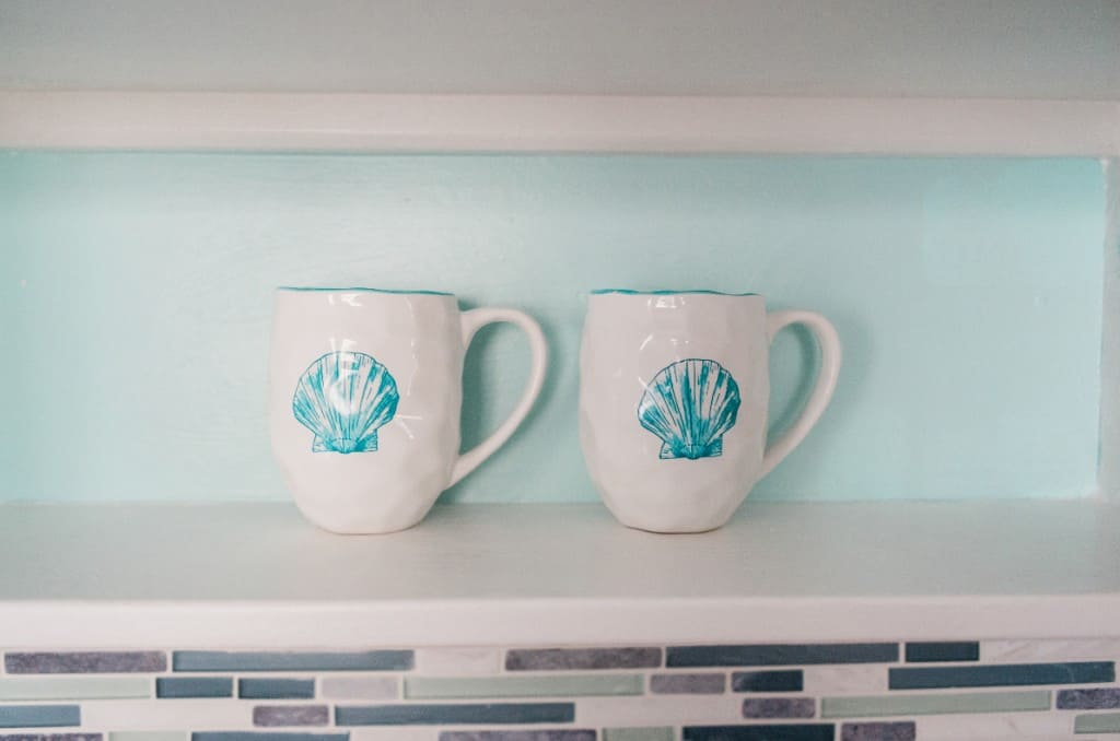 Open Shelving With Coastal Blue Back of Cabinets in Kitchen - Easy DIY Project