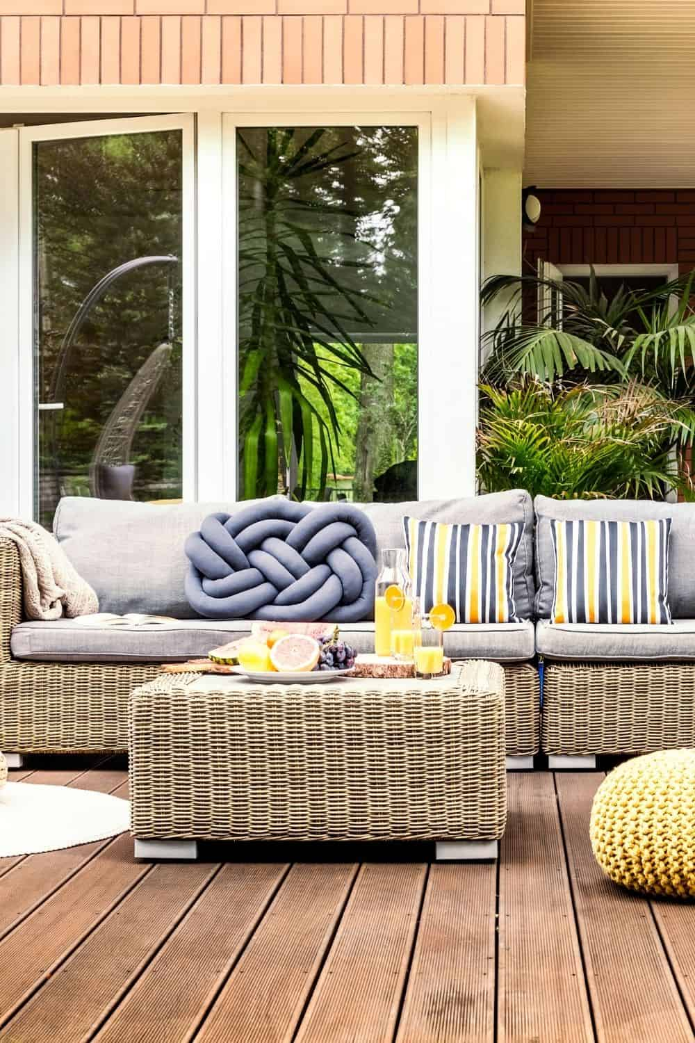 Outdoor couch with gray cushions and yellow accent pillows - Cozy Patio Ideas