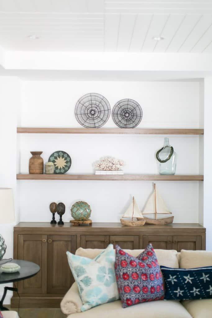 Living Room With Boho Colors - Built in shelf with seaglass, sailboat decor, boho decor pieces