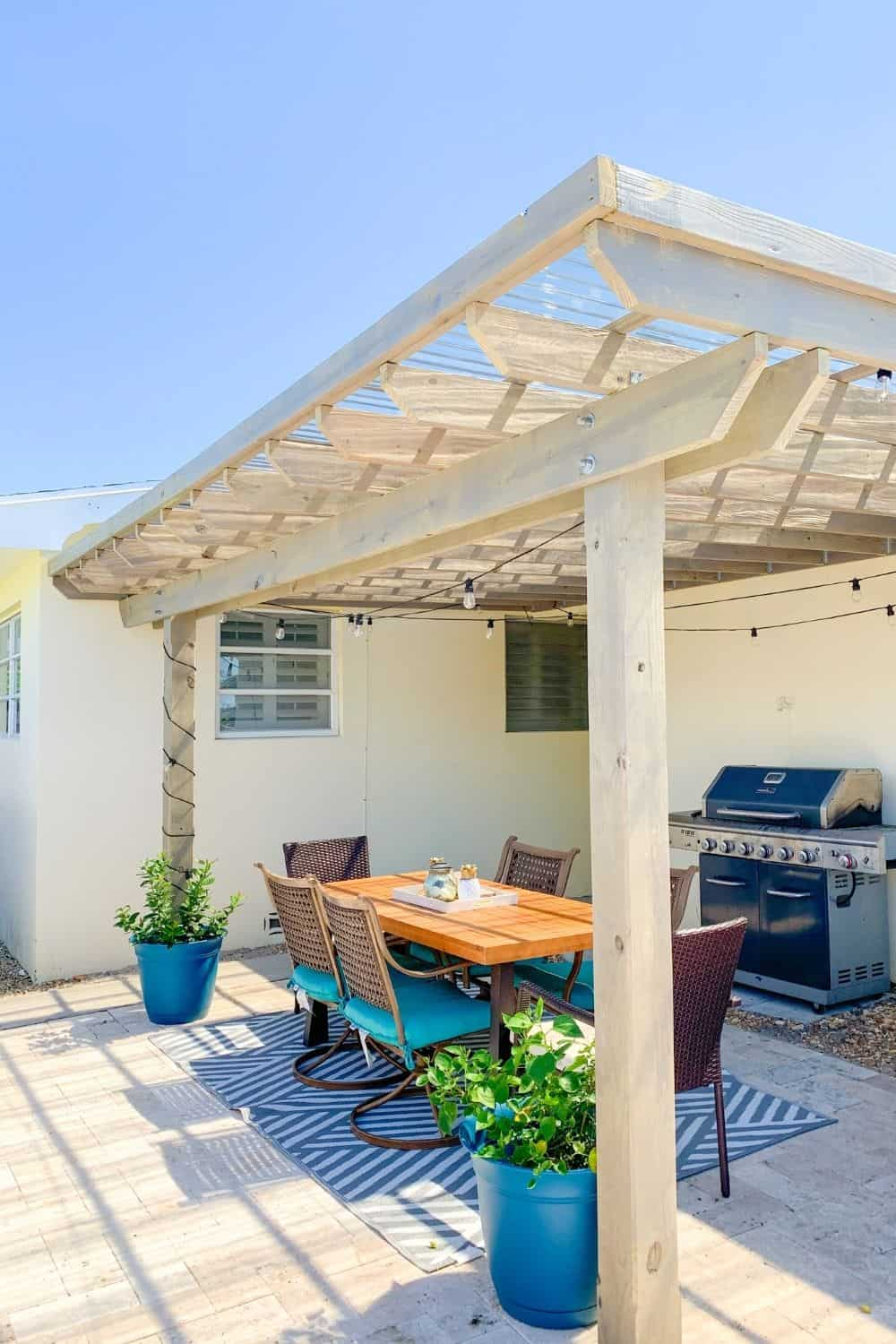Outdoor Pergola With String Lights and Cozy Table  - Cozy Patio Ideas For An Amazing Outdoor Space