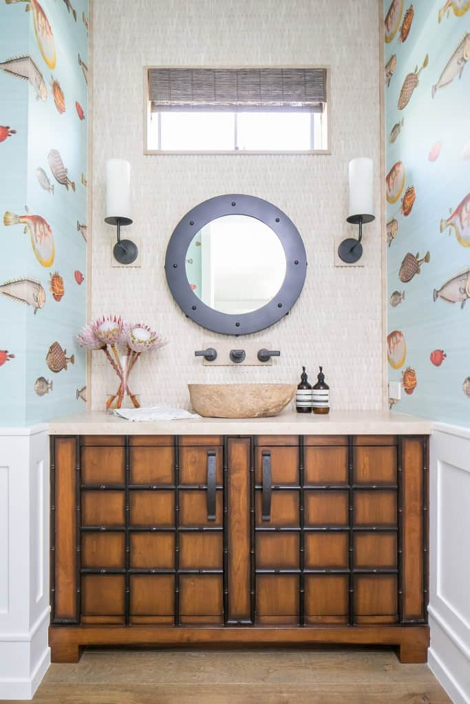 Whimsical Ocean Bathroom With Fish Wallpaper And Wood Trunk Vanity - Bold Nautical Bathroom Design