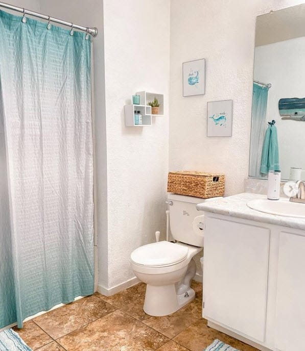 White bathroom makeover with teal blue whale art accents - Nautical Bathroom Designs With Unique Style And Chic Navy Blue Decor Ideas