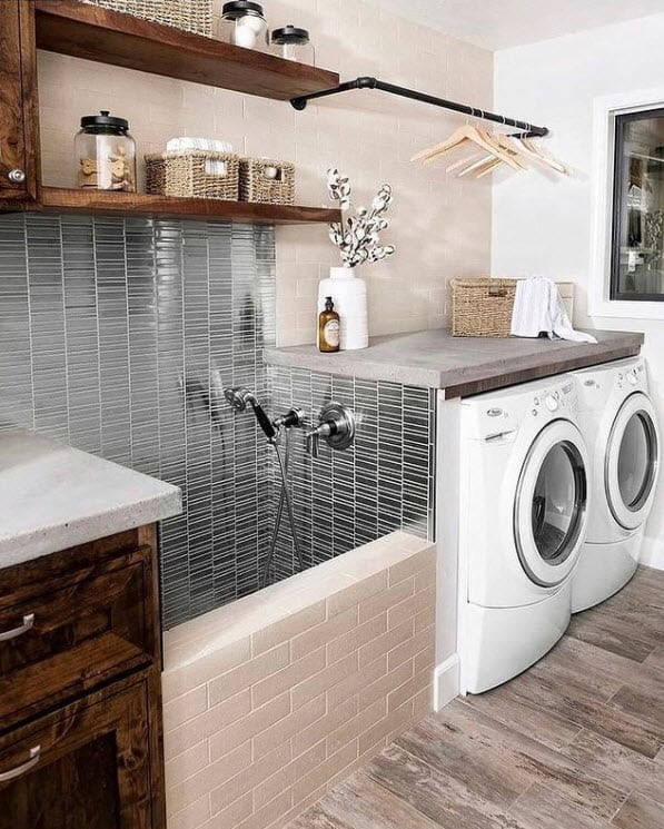 Laundry room with built in shelving.  Baskets are used for small towels.  Declutter your laundry room with baskets.