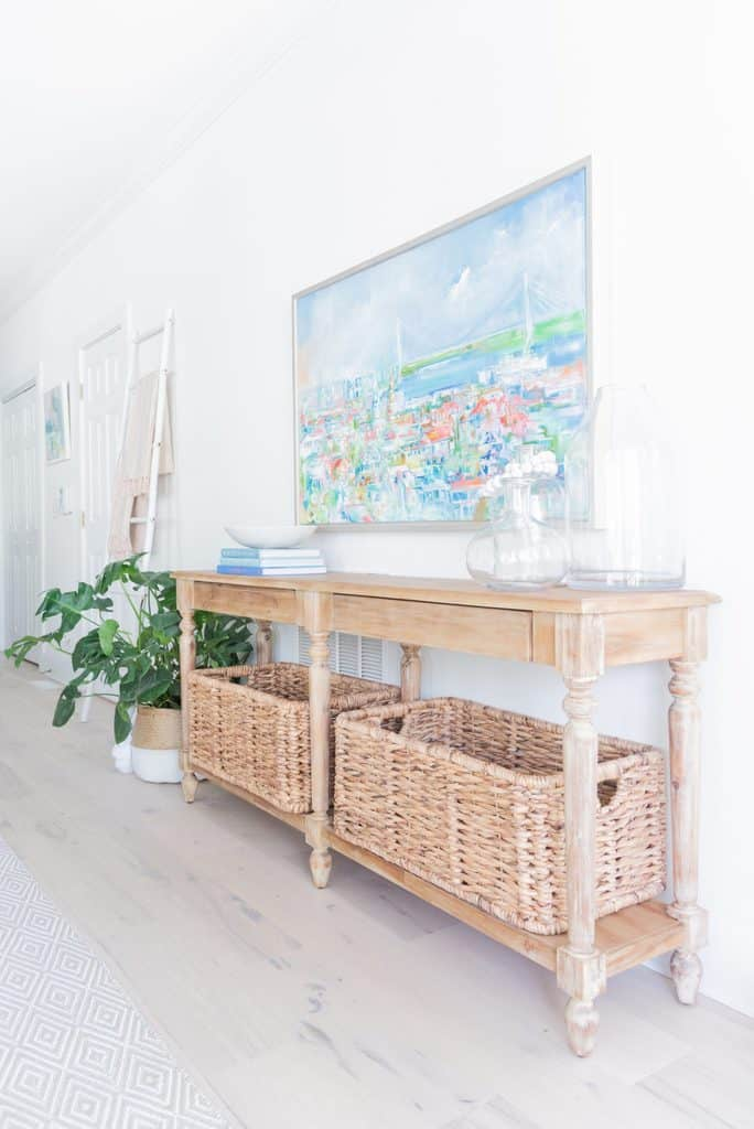 Light wood Entryway Table_baskets for storage_colorful sailboat painting