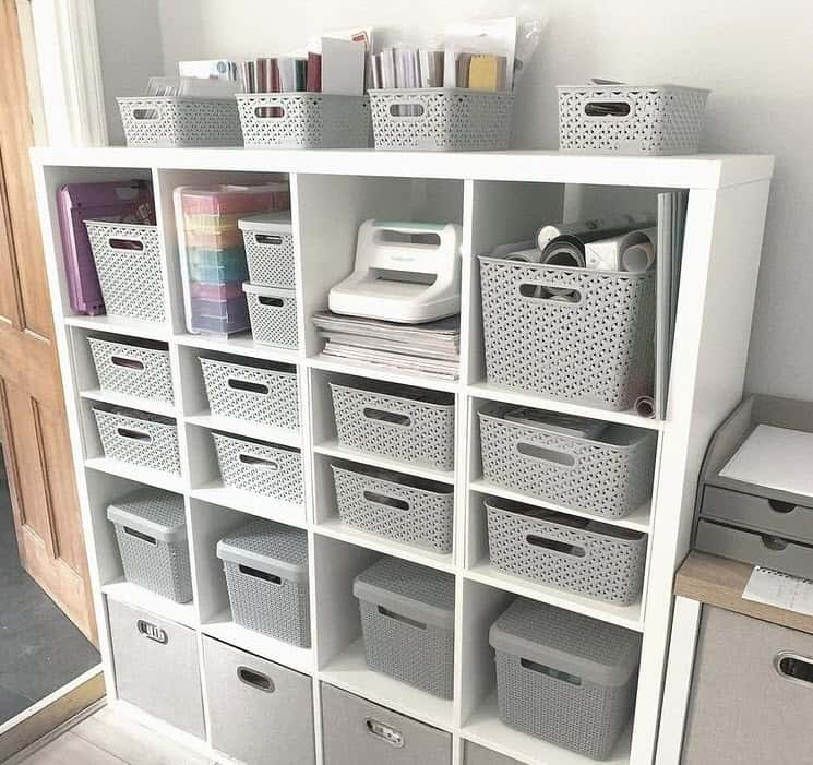 Office shelf with gray baskets for storage