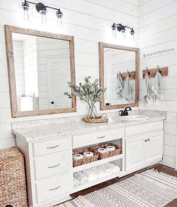 White Farmhouse Bathroom With Baskets For Organization