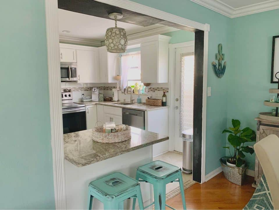 Beachy blues kitchen with low profile teal blue metal bar stools