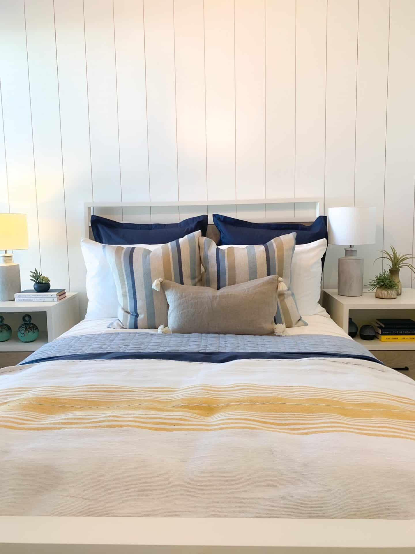 Guest Bedroom with white vertical shiplap wall