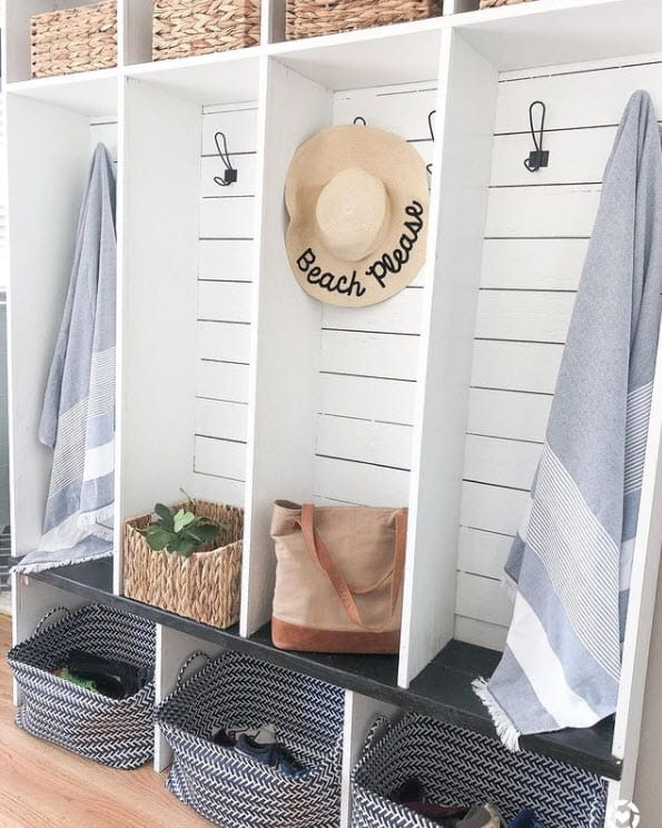 White Mudroom, built in storage and shelving, shiplap planks are used as a backing for a fresh coastal look