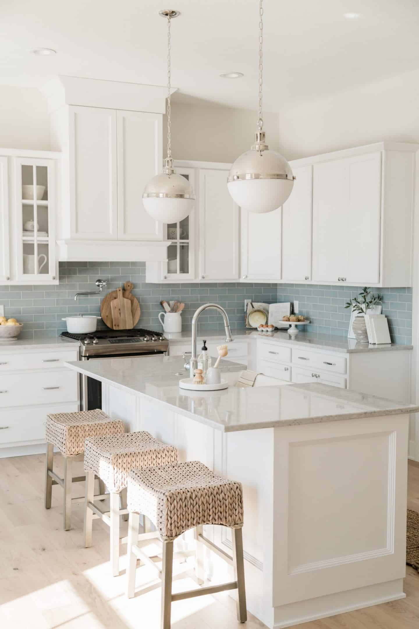 Airy White Kitchen, Ocean Blue Subway Tile Backsplash, Light Wicker Bar Stools at Kitchen Island