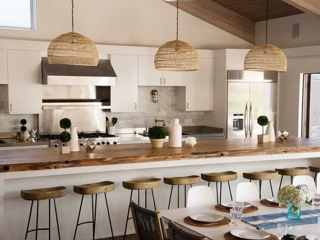 Large butcher block kitchen island, low profile bar stools, large set of 3 rattan hanging lights