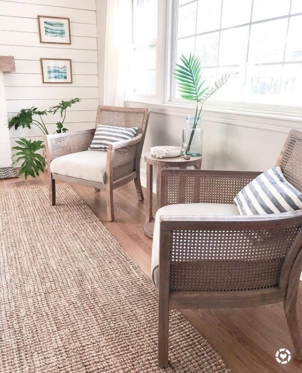 White Shiplap Accent Wall - Rattan Chairs in Coastal Sitting Area