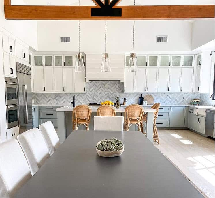 Chic Rattan Coastal Bar Stools in Light drenched white beach house kitchen