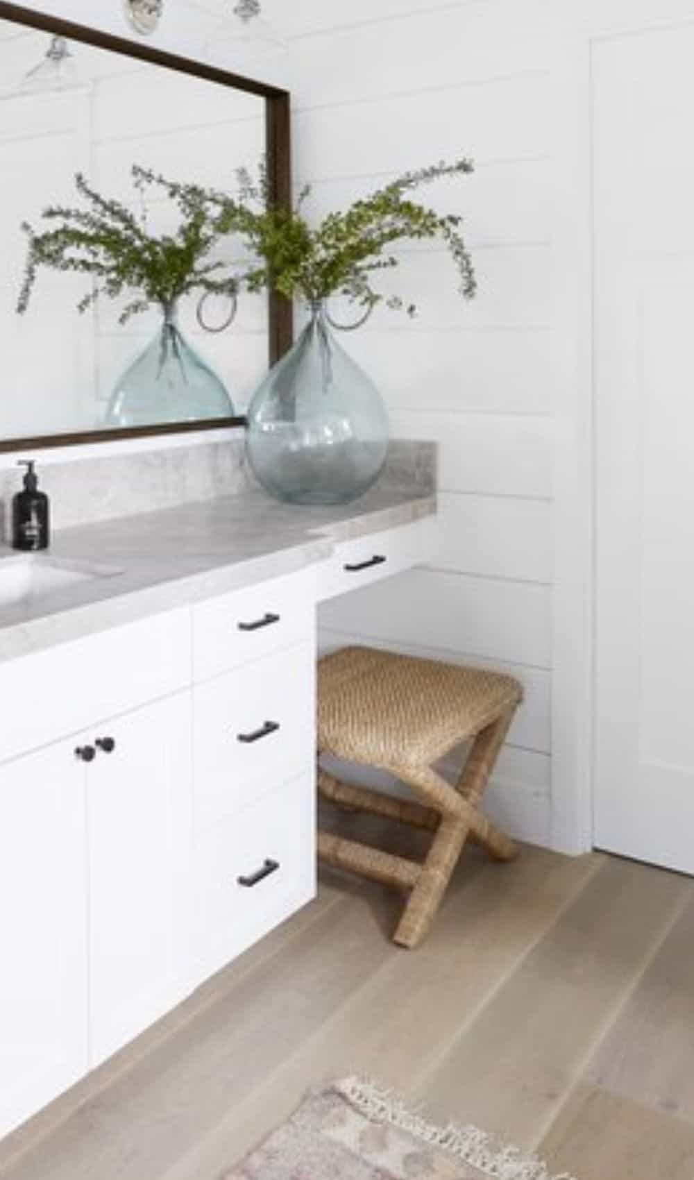 Calm Master Bathroom vanity - wicker rattan bench and seafoam glass vase
